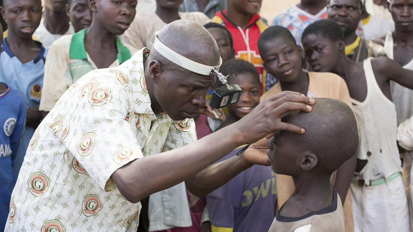 Ophthalmic nurse and lead surgeon, Aliyu A-Umar examines trachoma patient Abdu Ibrahim in Basansan, Kware.