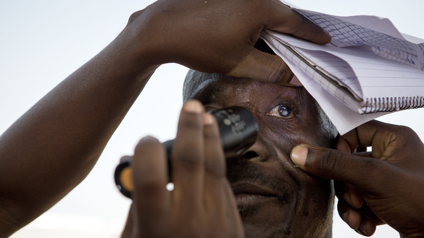 A man is checked for trachoma.