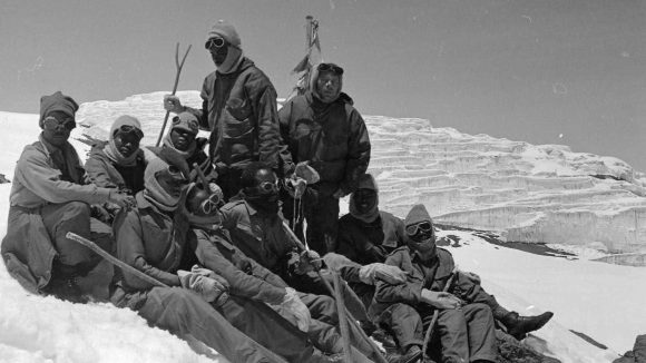 A team of climbers with visual impairments rest after reaching the top of Mount Kilimanjaro in 1969.