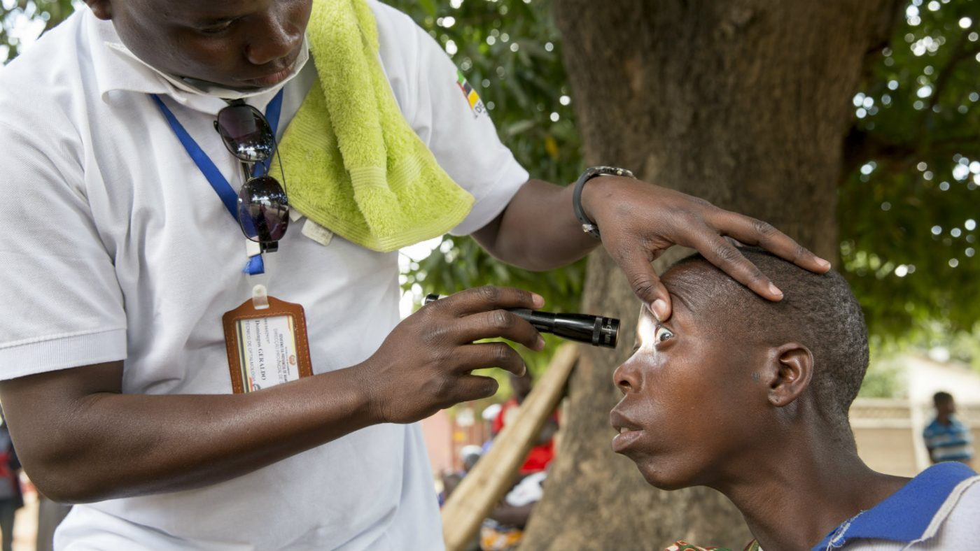 Laurinda's eyesight is tested by a health worker.