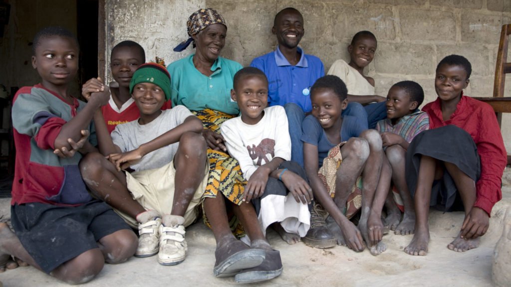 A group of smiling residents from the town of Mufulira in Zambia.