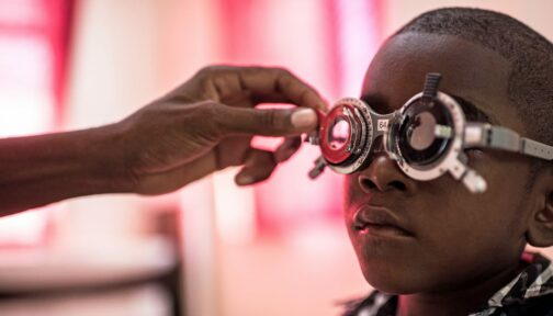 A boy having his eyes tested.