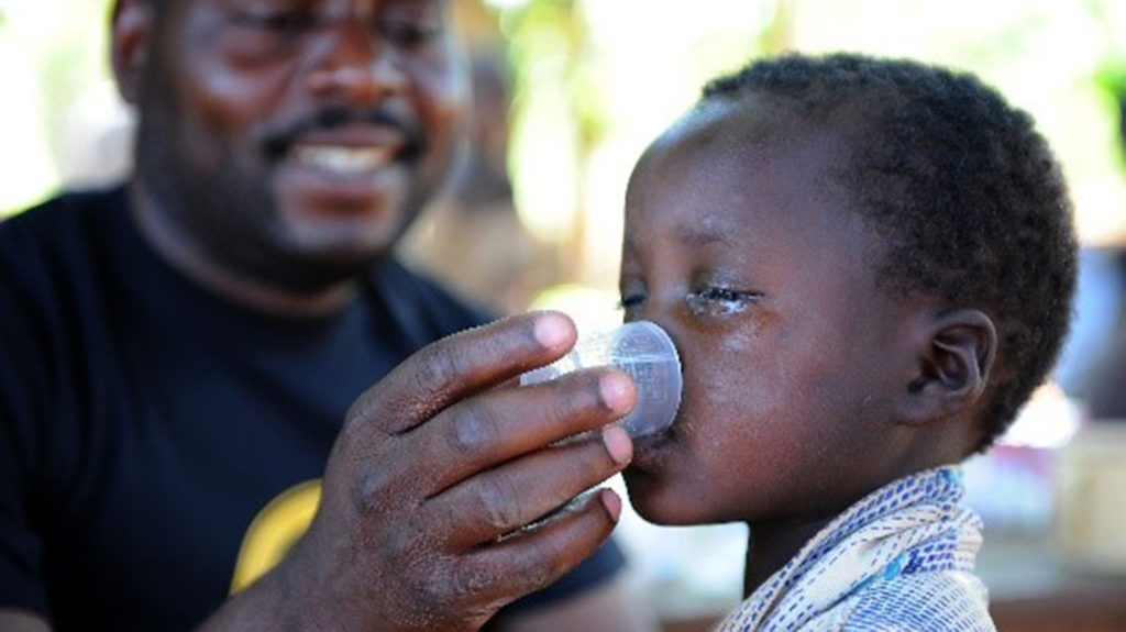 A child is given medication.