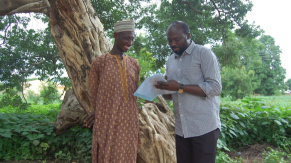 A man being counselled by a health worker.
