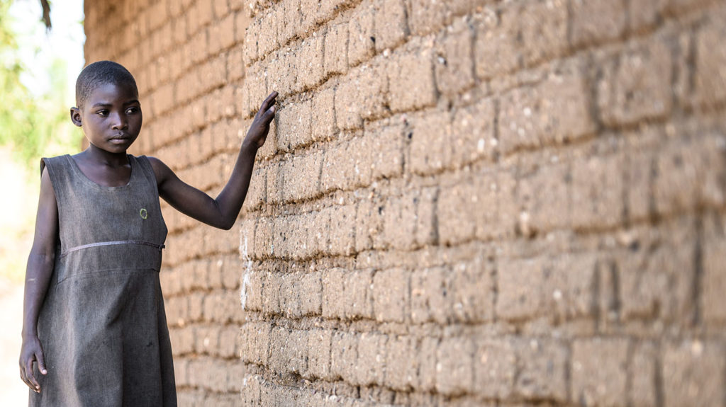 Mary uses her surroundings to guide her round her village in Malawi.
